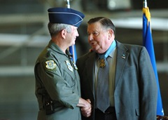 In good spirits MCCHORD AIR FORCE BASE, Wash.— Gen. Duncan McNabb, Air Mobility Command commander, congratulates Medal of Honor recipient, retired Col. Joe Jackson, during the naming of a McChord C-17 Globemaster III as the Spirit of Col. Joe M. Jackson recently. U.S. Air Force/Photo by Abner Guzman